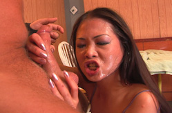 Asian brunette deepthroats cock